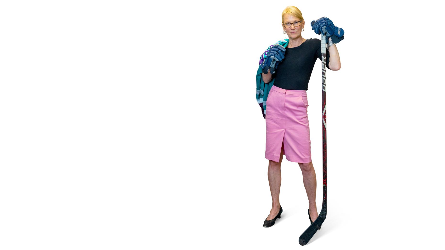 Molly Kellogg of Waterbury CT wearing hockey goalie gloves and holding a hockey stick