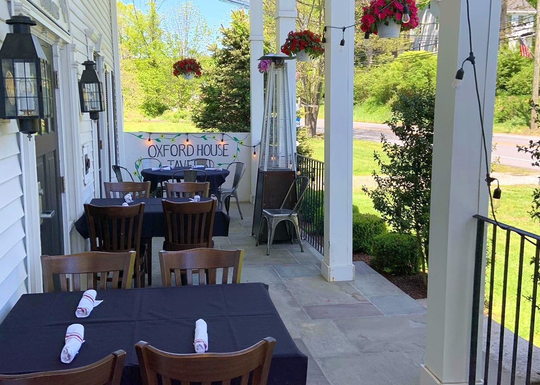 Dining area on the front porch of the Oxford House Tavern in Oxford, CT