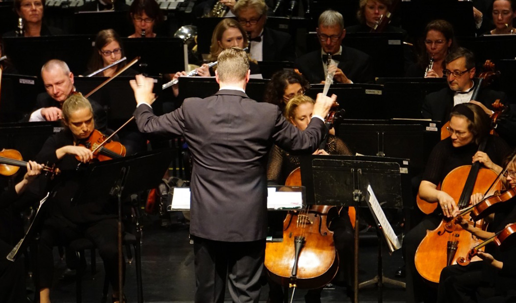 Musicians and conductor playing in the Waterbury Symphony Orchestra