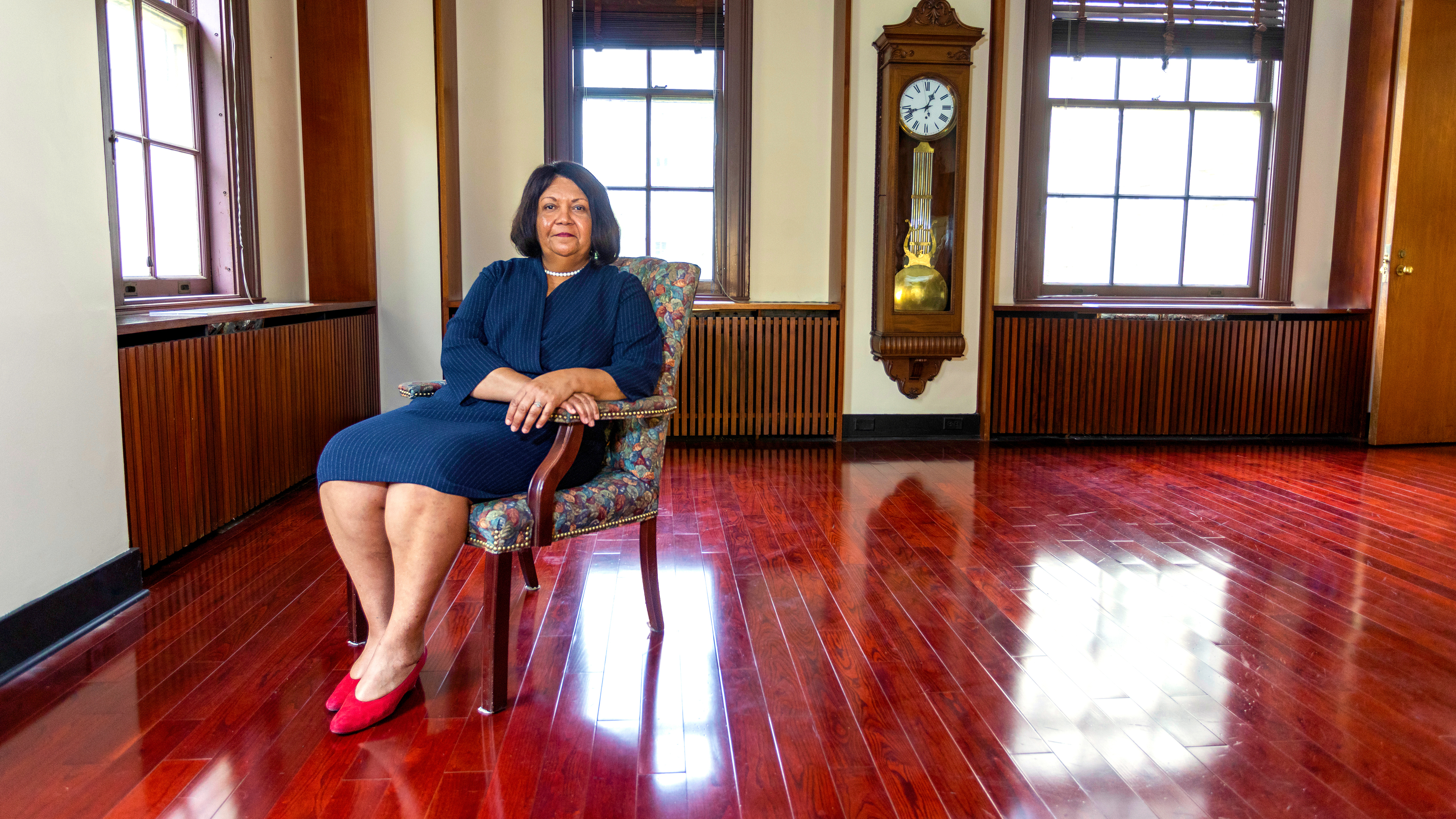 Waterbury CT Public Schools Superintendent Verna Ruffin sitting in a chair in her office