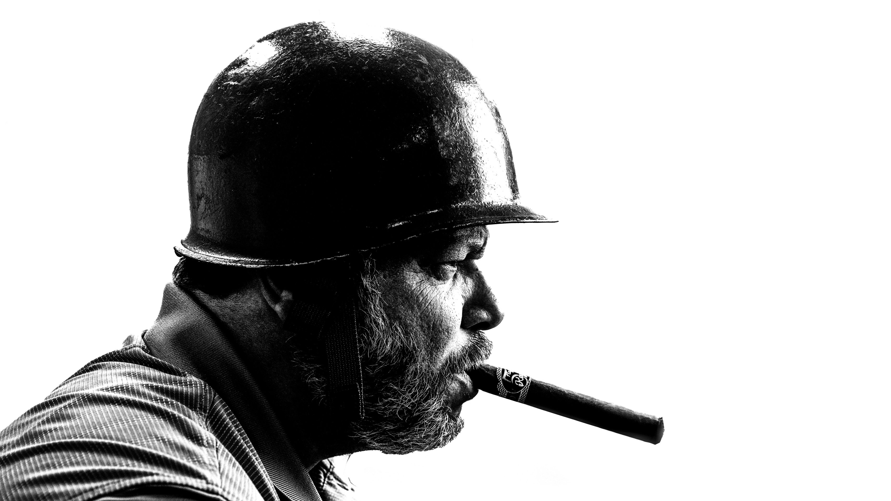 A black and white profile headshot of Frank Monteiro of Waterbury CT wearing an army helmet, cigar in mouth