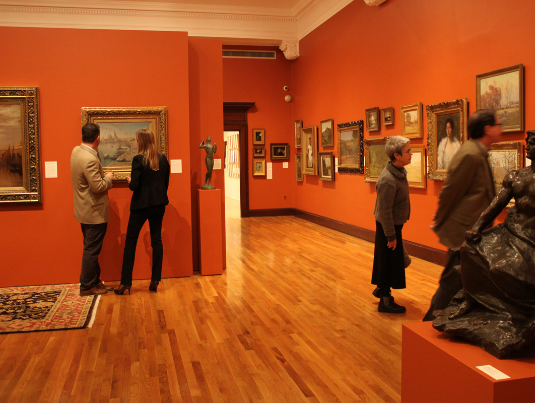Patrons looking at the art hung on the walls of the Mattatuck Museum in Waterbury CT