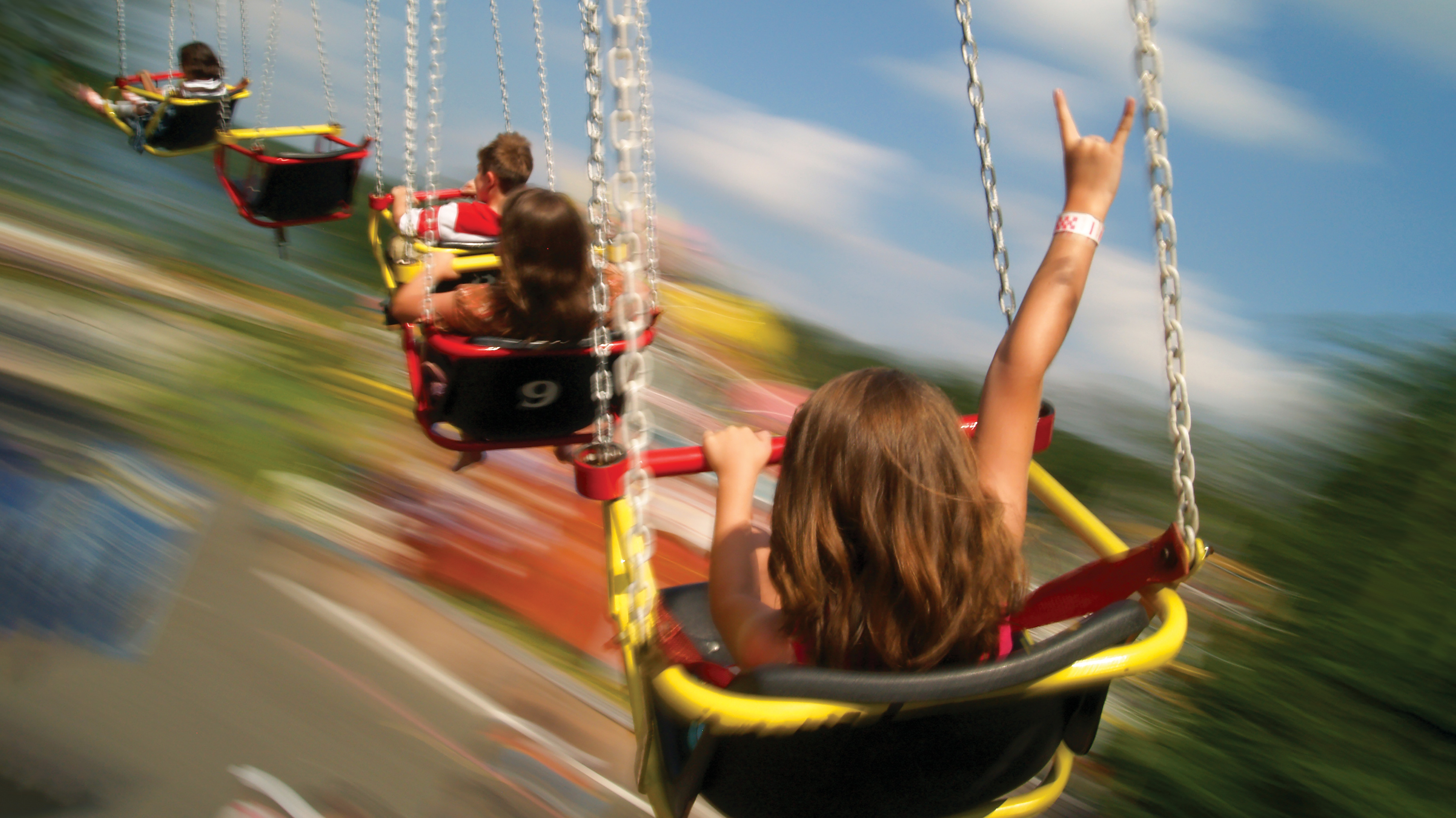 Kids enjoying the roller coaster at Quassy Amusement Park in Middlebury, CT