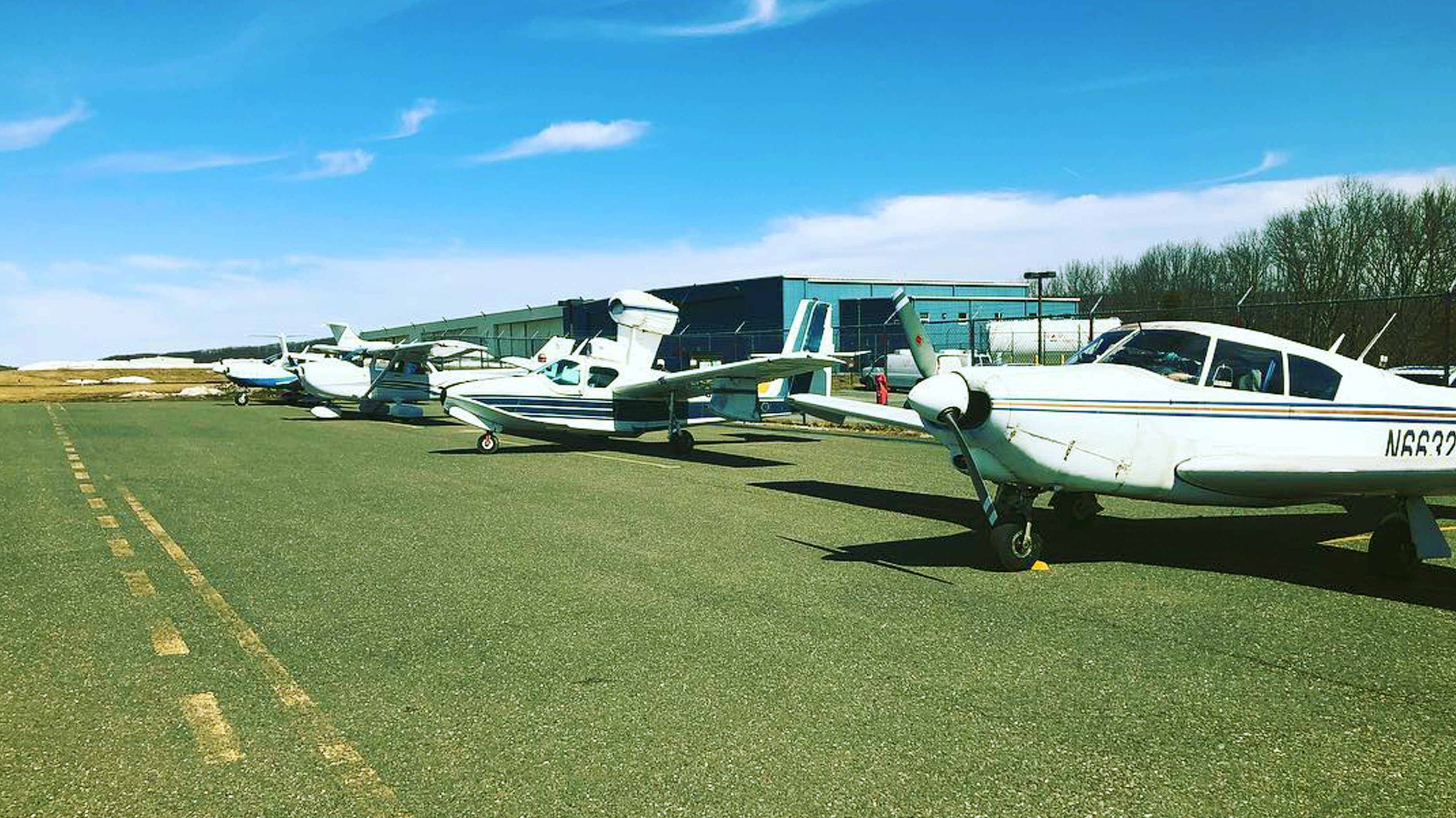 View of several airplanes at the Waterbury-Oxford Airport