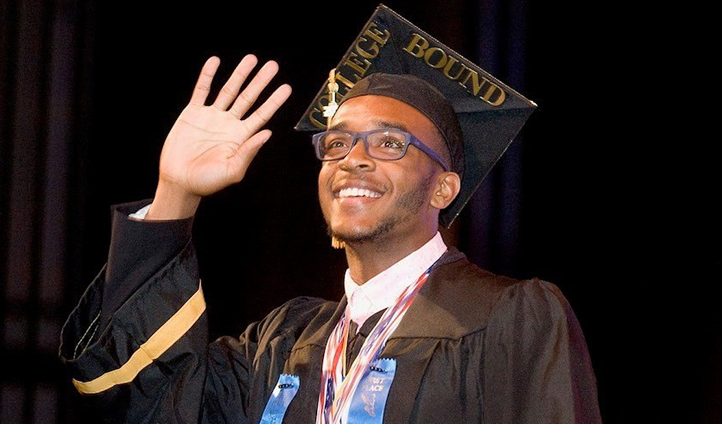 Male Waterbury CT high school student at graduation smiling and waving