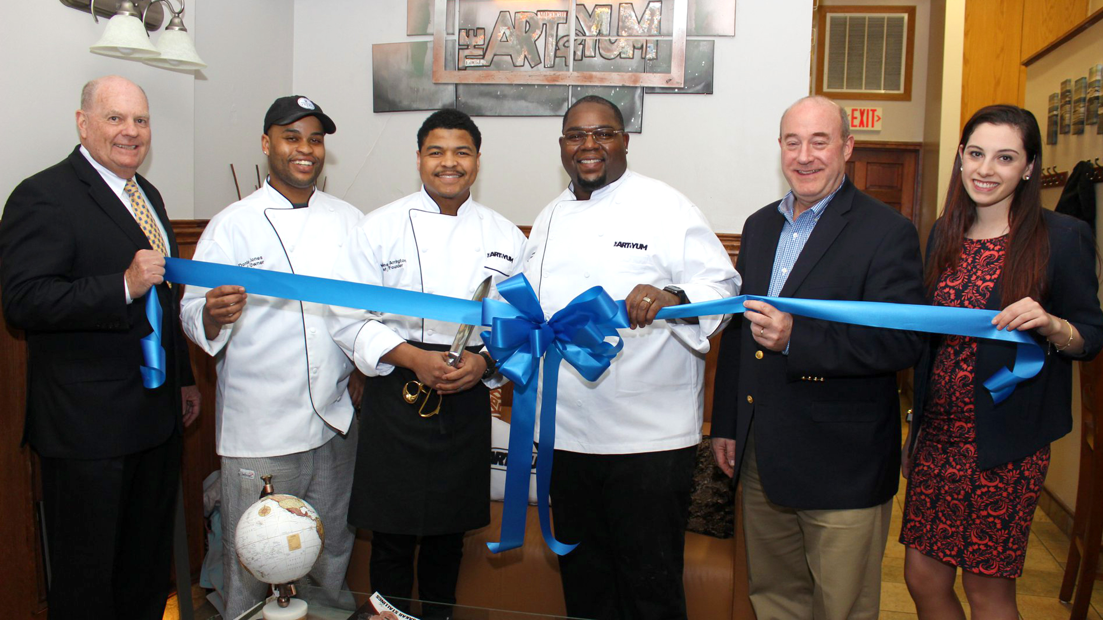 Ribbon cutting ceremony for the opening of The Art Of Yum in 2019