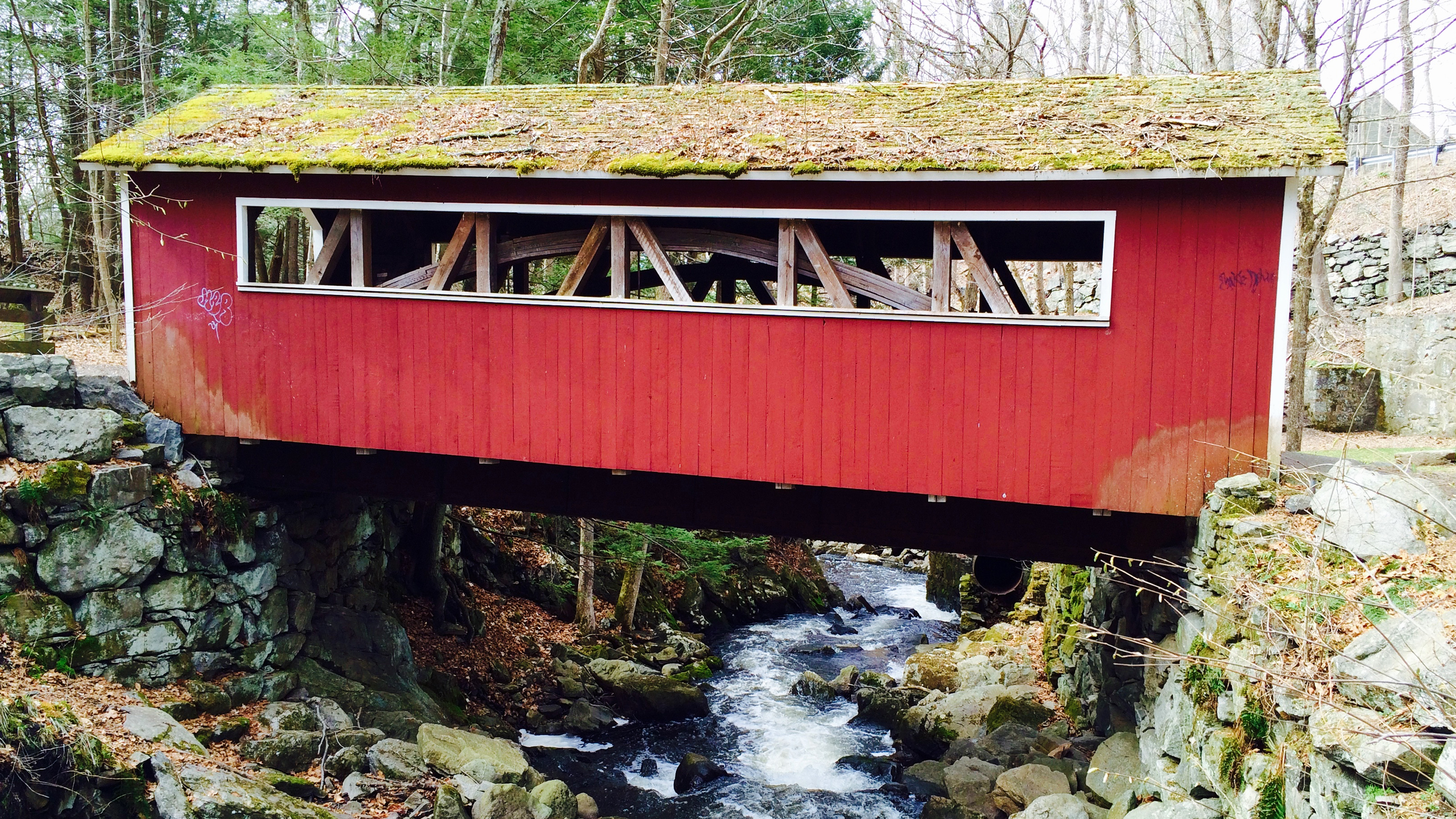 Red covered bridge over Eight Mile Brook in Southbury, CT