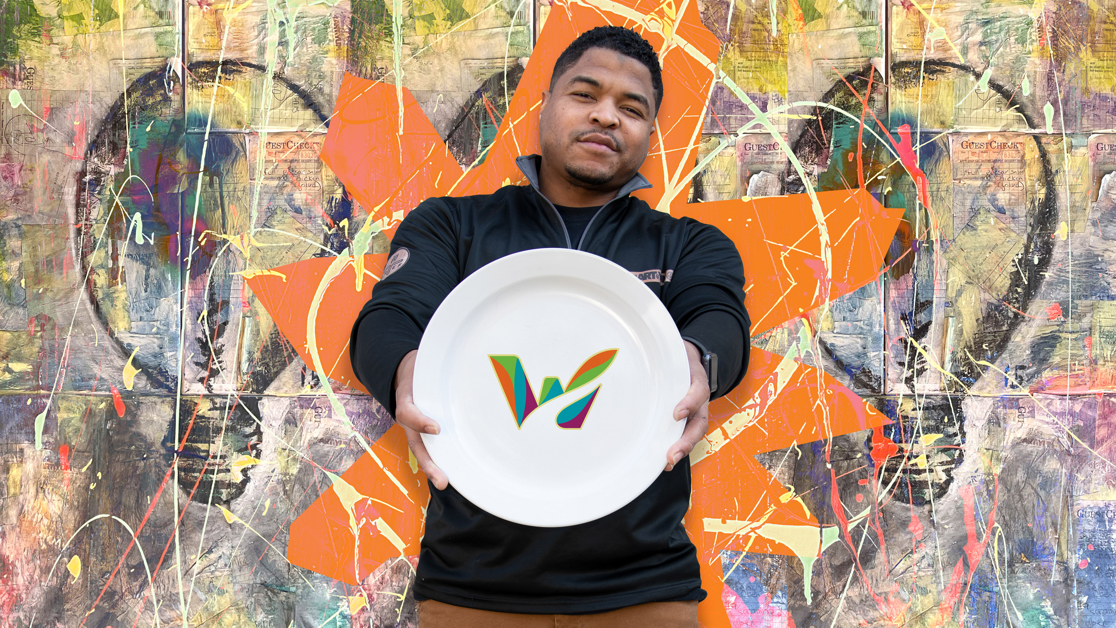 The Art Of Yum celebrity chef Michone Arrington holding a plate with the Waterbury logo on it