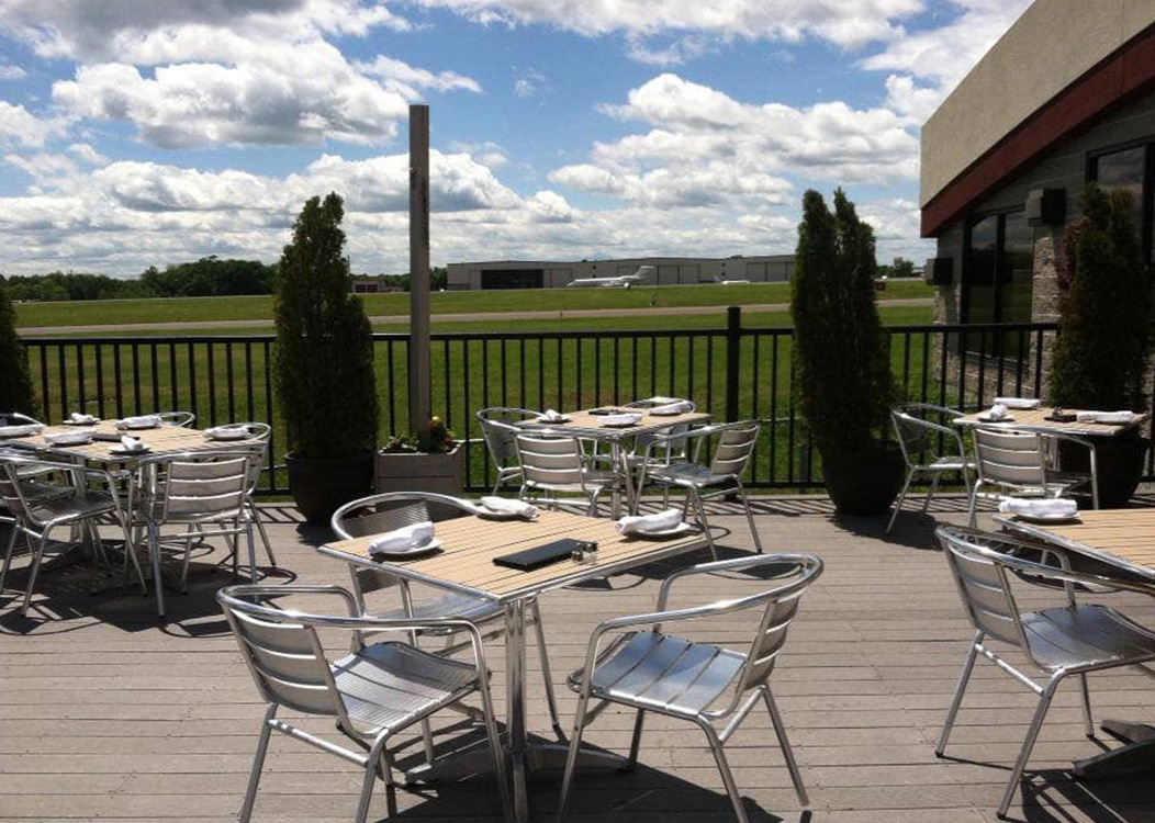 Outdoor patio dining area at 121 Restaurant overlooking the Waterbury-Oxford Airport in Oxford, CT