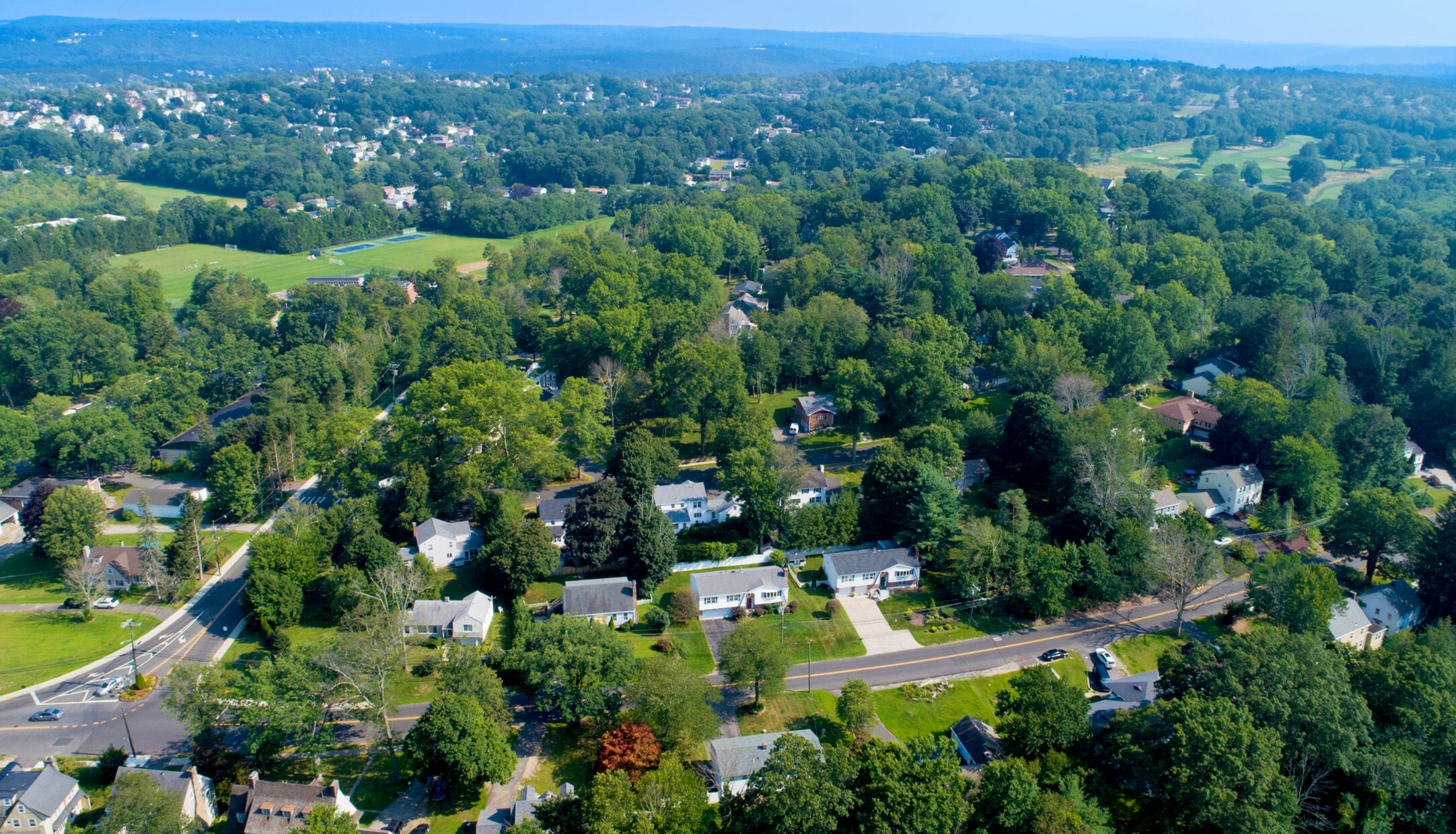 An aerial view of houses and streets in the Country Club neighborhood of Waterbury
