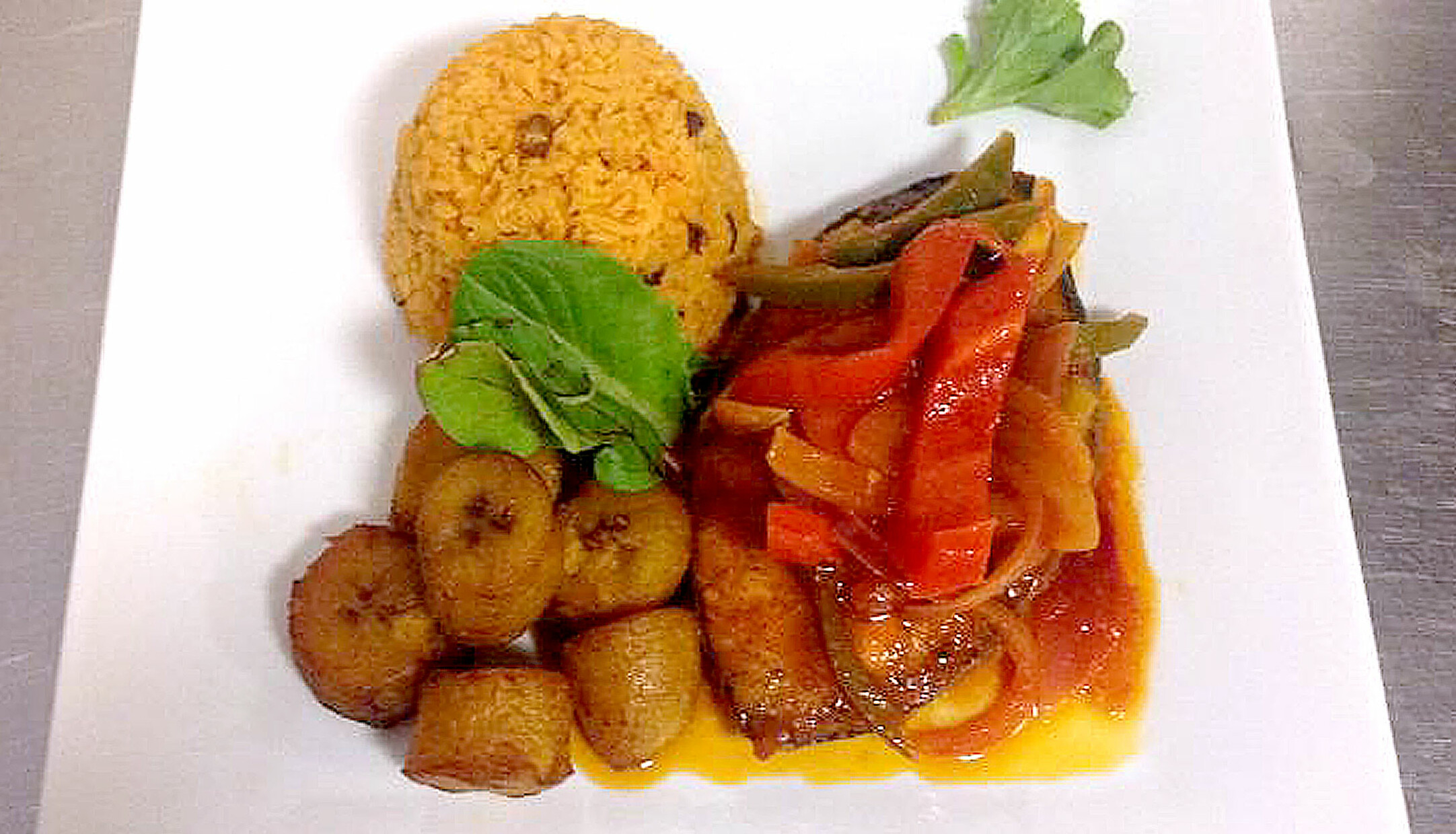 Plate of Dominican cuisine for La Cazuela Restaurant in Waterbury CT