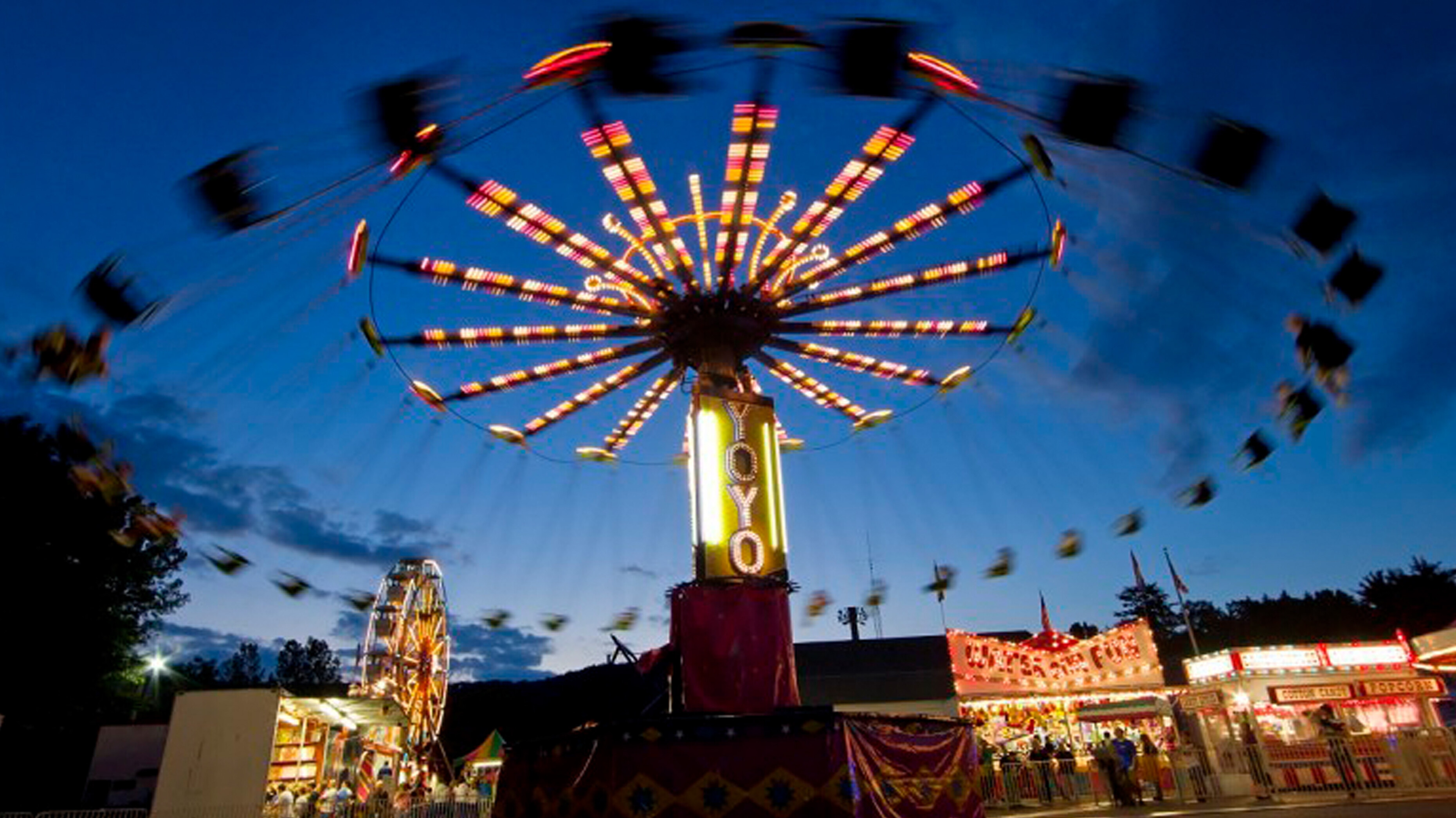 A spinning swings ride in motion at the Firemens Carnival in Beacon Falls CT