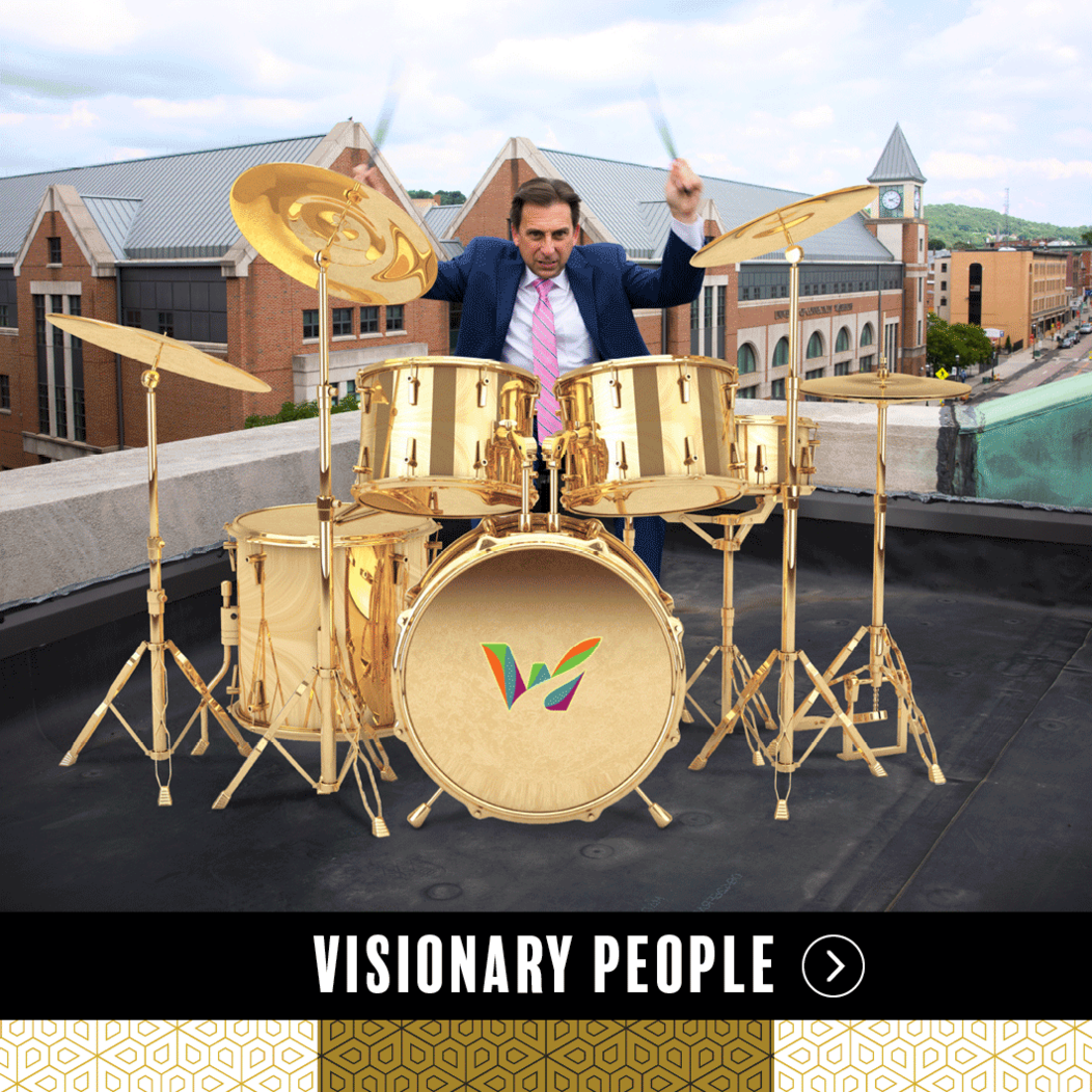 Joe Gramando of Waterbury CT playing drums on a rooftop, representing Visionary People