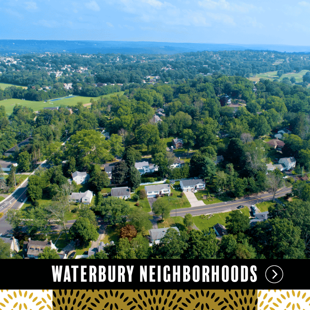 An aerial view of houses and streets in one of the residential areas of Waterbury CT, representing Waterbury Neighborhoods