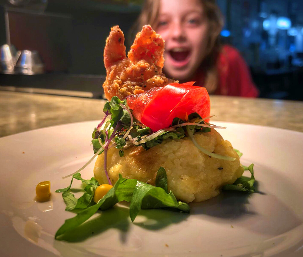 Child looking at elaborately plated dish with excitement at The Art of Yum in Waterbury