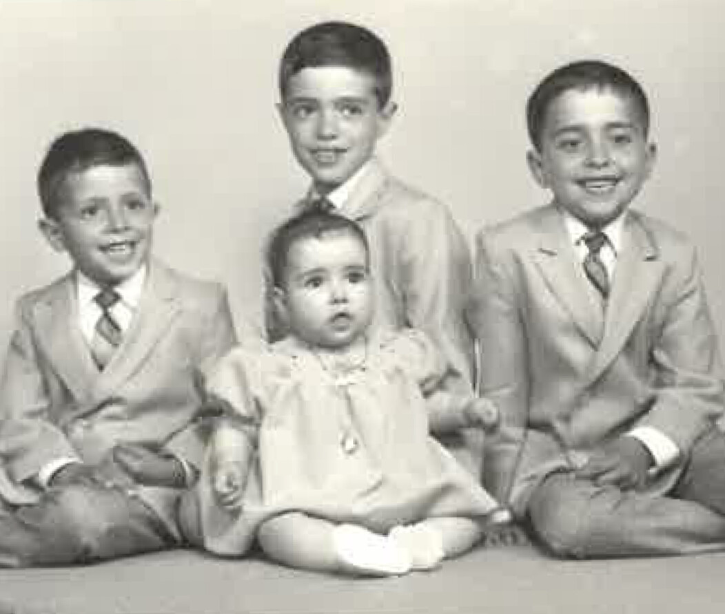 A black and white photo of Frank Tavera of Waterbury as a young child with his siblings