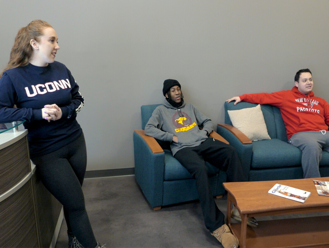 Two UConn Waterbury students lounging at the residence hall at the Brown Building