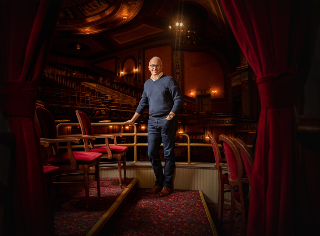 Frank Tavera, the CEO of The Palace Theater in Waterbury CT, standing in the audience seats